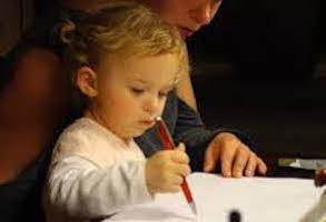 Child drawing in notebook