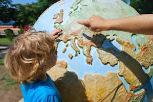 Child looking at globe